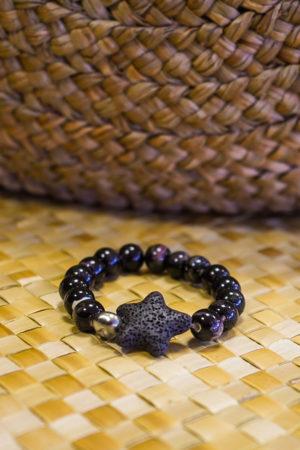 Bracelet noir en graines avec perles de Tahiti